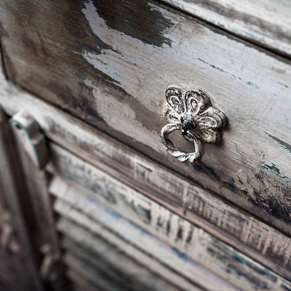 the handle of an old rustic cupboard a drawer ** Note: Shallow depth of field